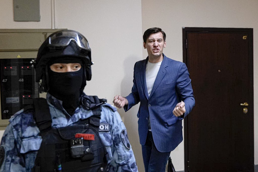 FILE - In this June 1, 2021, frame from video, Russian opposition activist Dmitry Gudkov gestures speaking to the media as police search at his countr...