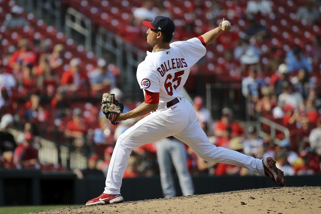 St. Louis Cardinals relief pitcher Giovanny Gallegos delivers during the ninth inning of a baseball game against the Cincinnati Reds, Sunday, Sept. 12...