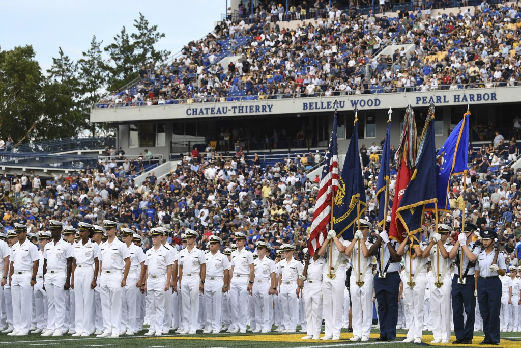 The Brigade of Midshipmen stand at attention during pre-game ceremonies before an NCAA college football game between Navy and Air Force, Saturday, Sep...