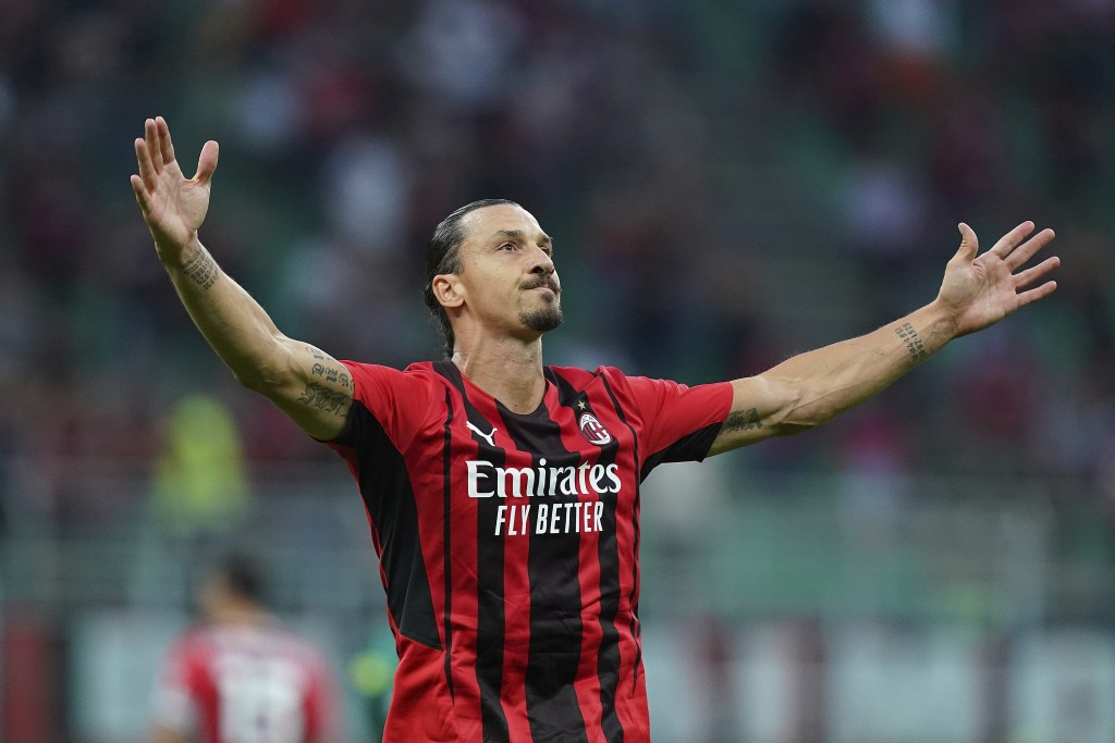 Milan's Zlatan Ibrahimovic celebrates after scoring  his side's seconf goal during the Italian Serie A soccer match between Milan and Lazio at the San...