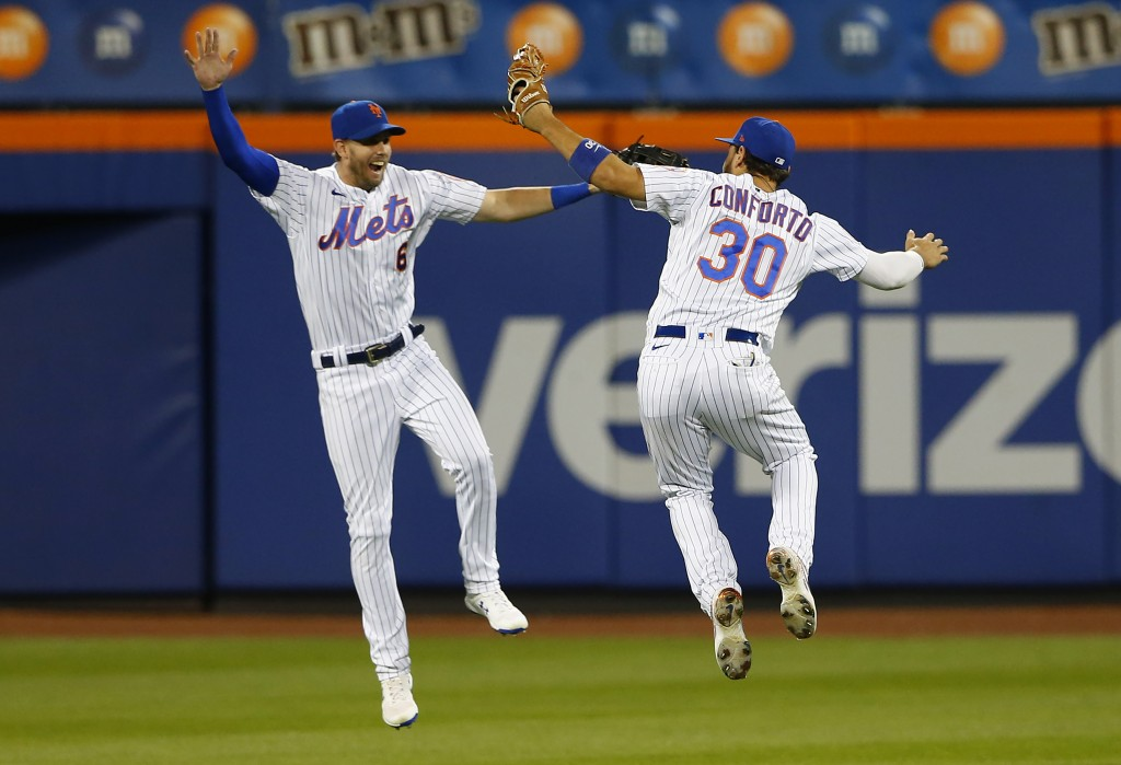 New York Mets' Jeff McNeil (6) and Michael Conforto (30) celebrate after defeating the New York Yankees, Sunday, Sept. 12, 2021, in New York. (AP Phot...