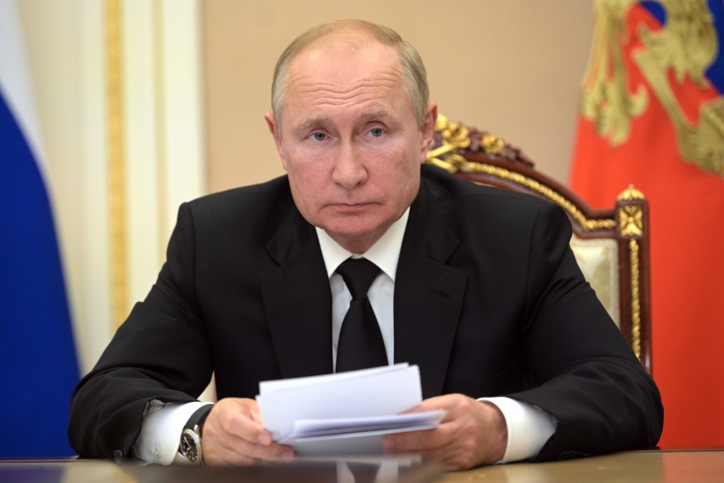 FILE - In this Thursday, Sept. 9, 2021 file photo, Russian President Vladimir Putin speaks during a meeting in Moscow, Russia. The Kremlin says Russia...