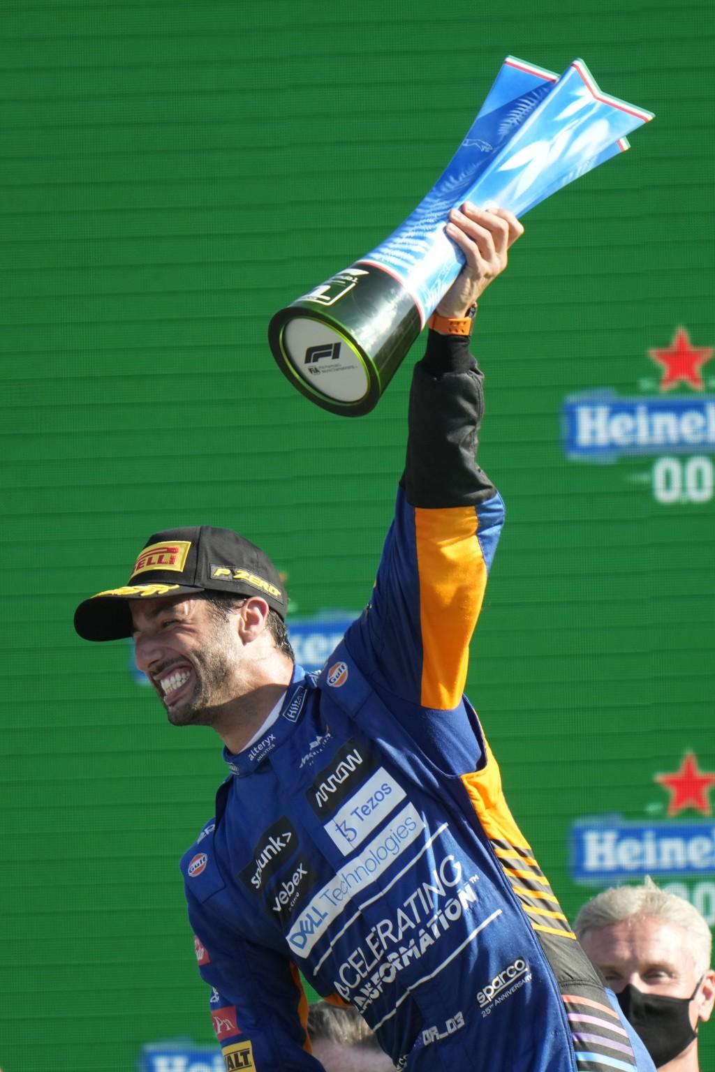 Mclaren driver Daniel Ricciardo of Australia celebrates after winning during the Italian Formula One Grand Prix, at Monza racetrack, in Monza, Italy, ...