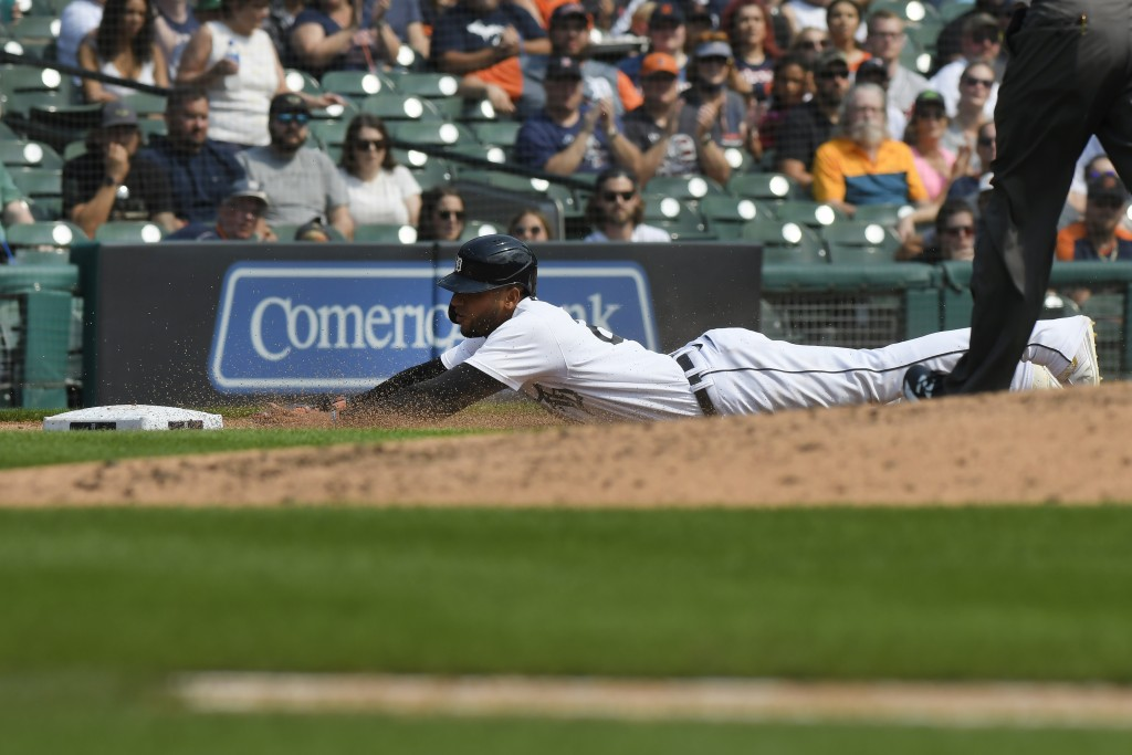 Detroit Tigers' Victor Reyes slides safely into third base on a single from Akil Baddoo in the fifth inning of a baseball game against the Tampa Bay R...