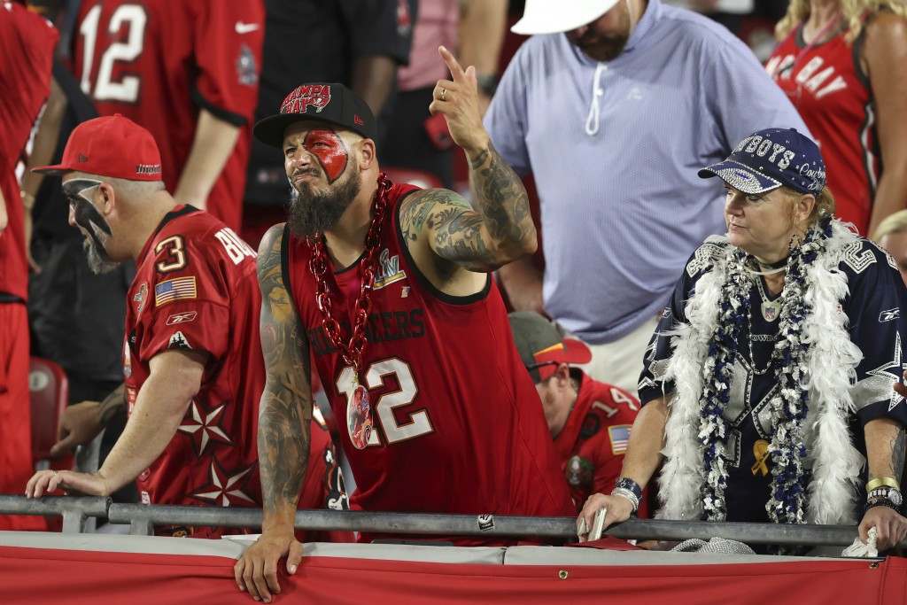 Fans react during the second half of an NFL football game between the Tampa Bay Buccaneers and the Dallas Cowboys on Thursday, Sept. 9, 2021, in Tampa...