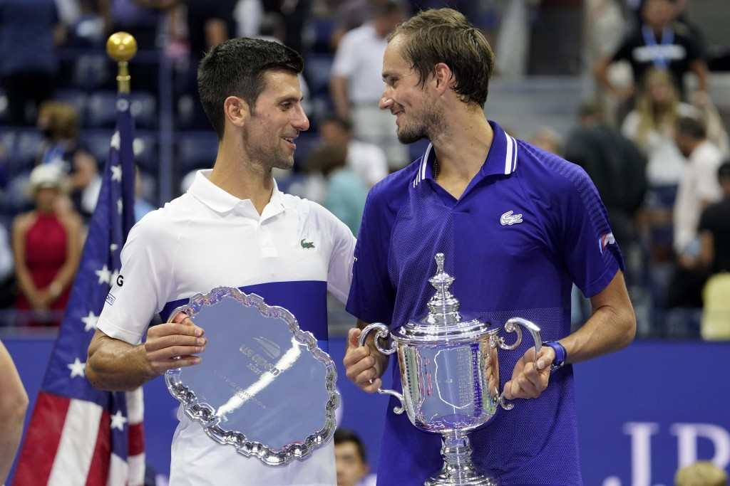 Novak Djokovic, of Serbia, left, and Daniil Medvedev, of Russia, talk during the trophy ceremony after the men's singles final of the US Open tennis c...