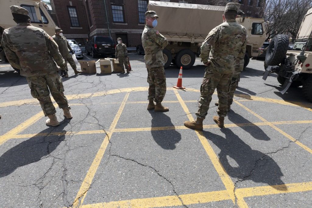 FILE — Massachusetts National Guard soldiers help with logistics in this Friday, April 17, 2020 file photo, at a food distribution site outside City H...