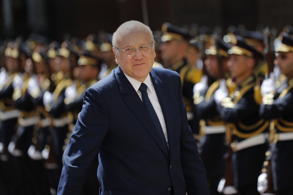 Lebanese Prime Minister Najib Mikati, reviews an honor guard during a ceremony held on his first day in office, at the Government House in downtown Be...