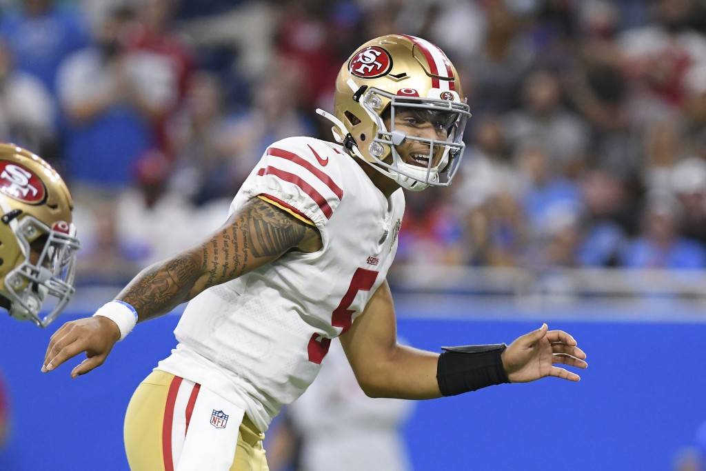 San Francisco 49ers quarterback Trey Lance signals at the line of scrimmage against the Detroit Lions In the first half of an NFL football game in Det...
