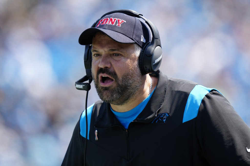 Carolina Panthers head coach Matt Rhule watches during the first half of an NFL football game against the New York Jets Sunday, Sept. 12, 2021, in Cha...