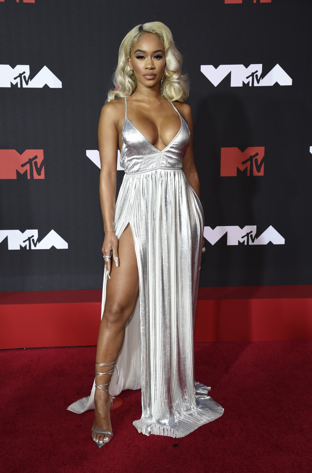 Saweetie arrives at the MTV Video Music Awards at Barclays Center on Sunday, Sept. 12, 2021, in New York. (Photo by Evan Agostini/Invision/AP)