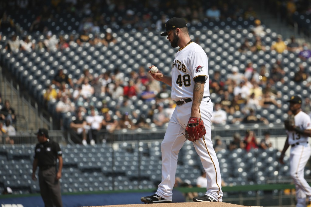 Pittsburgh Pirates starter Bryse Wilson prepares to pitch in the first inning during a baseball game against the Washington Nationals, Sunday, Sept. 1...
