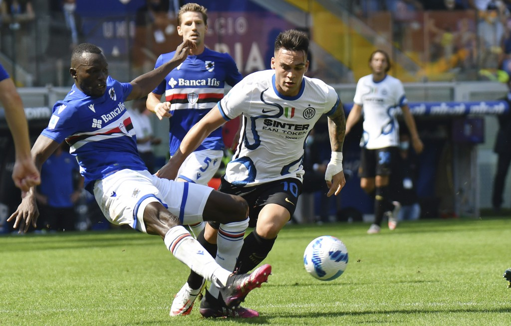 Inter's Lautaro Martinez, and Sampdoria's Omar Colley vie for the ball during the Italian Serie A soccer match between Sampdoria and Inter Milan at th...