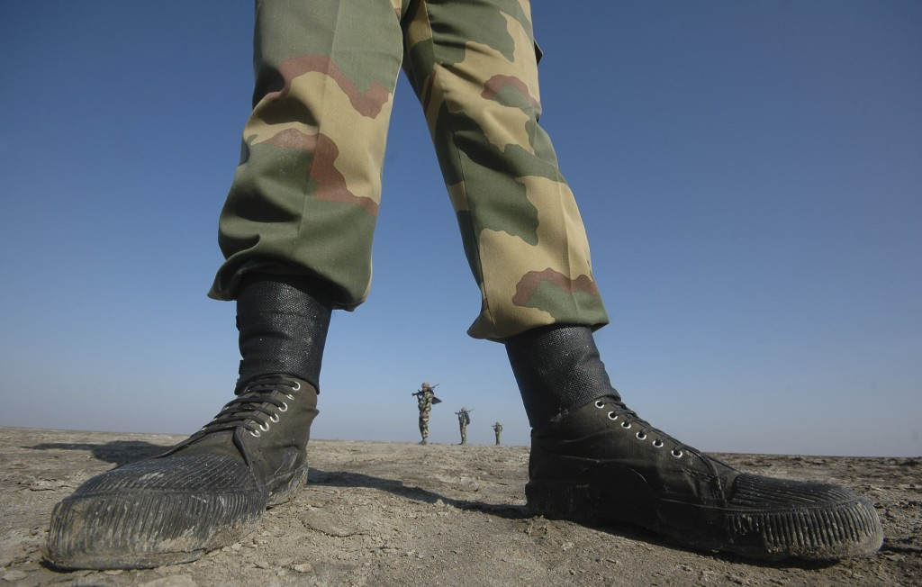 FILE - In this Nov. 25, 2009, file photo, India's Border Security Force (BSF) soldiers patrol at the border with Pakistan in Kutch district, about 550...