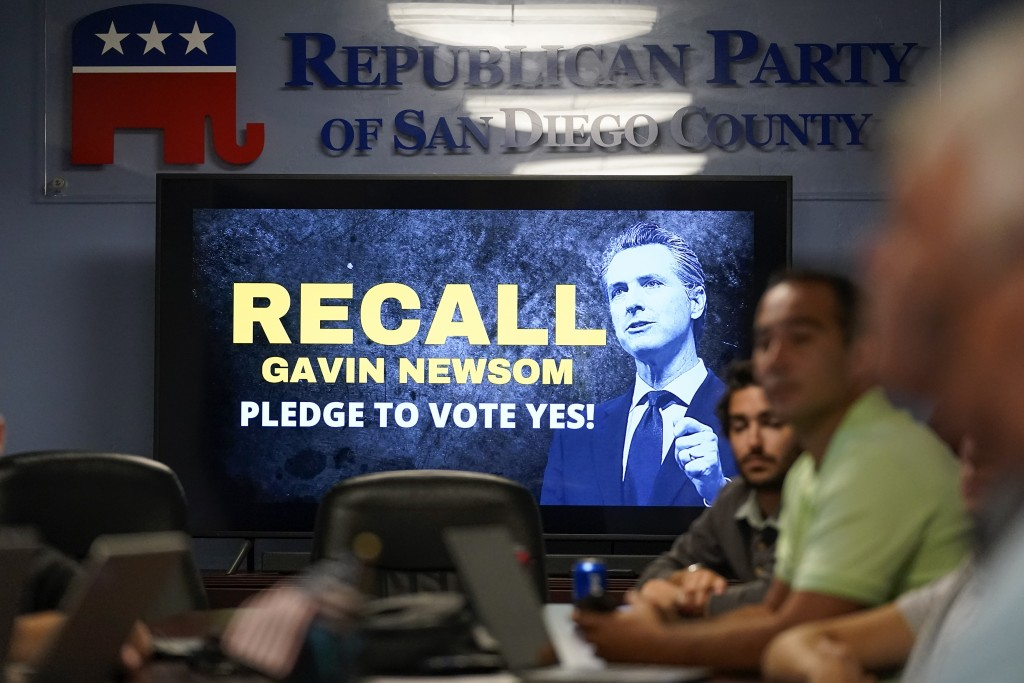 People listen during a meeting of volunteers to get out the vote by supporters of the effort to recall California Gov. Gavin Newsom at the San Diego R...