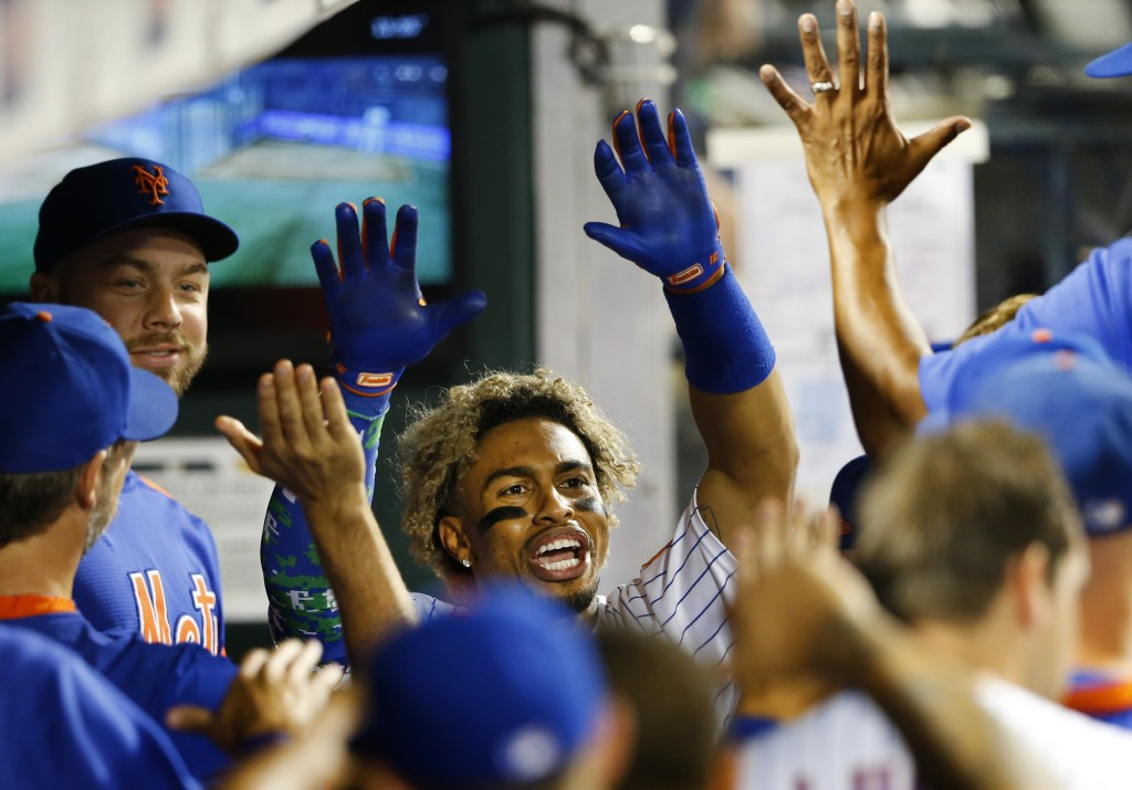 New York Mets' Francisco Lindor celebrates after hitting a home run against the New York Yankees during the eighth inning of a baseball game on Sunday...