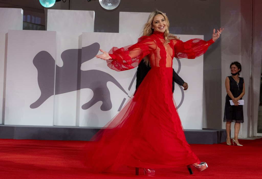 FILE - In this Sept, 5, 2021 file photo Kate Hudson poses for photographers upon arrival at the premiere of the film 'Mona Lisa And The Blood Moon' du...