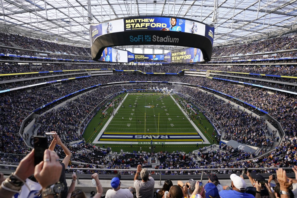 Fans react in SoFi stadium before an NFL football game between the Los Angeles Rams and the Chicago Bears, Sunday, Sept. 12, 2021, in Inglewood, Calif...
