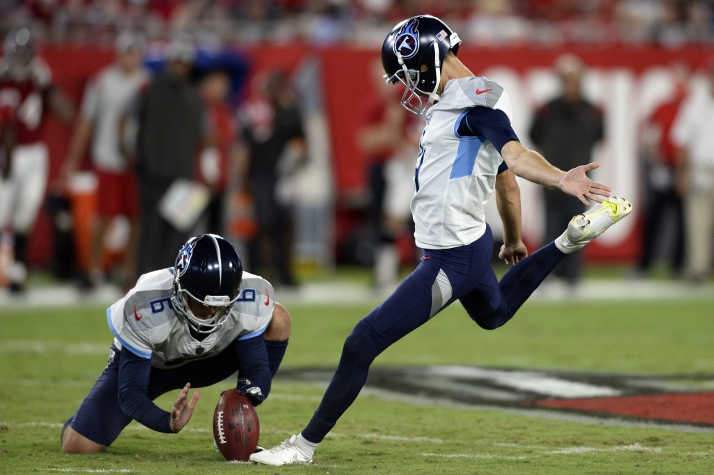 FILE - In this Aug 21, 2021, file photo, Tennessee Titans' Sam Ficken, right, boots a field goal against the Tampa Bay Buccaneers as punter Brett Kern...