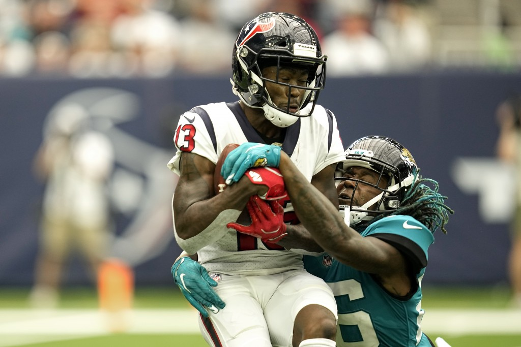 Houston Texans wide receiver Brandin Cooks (13) catches a pass for a first down as Jacksonville Jaguars cornerback Shaquill Griffin (26) defends durin...