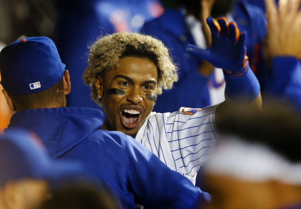 New York Mets' Francisco Lindor celebrates in the dugout after hitting a home run against the New York Yankees during the eighth inning of a baseball ...