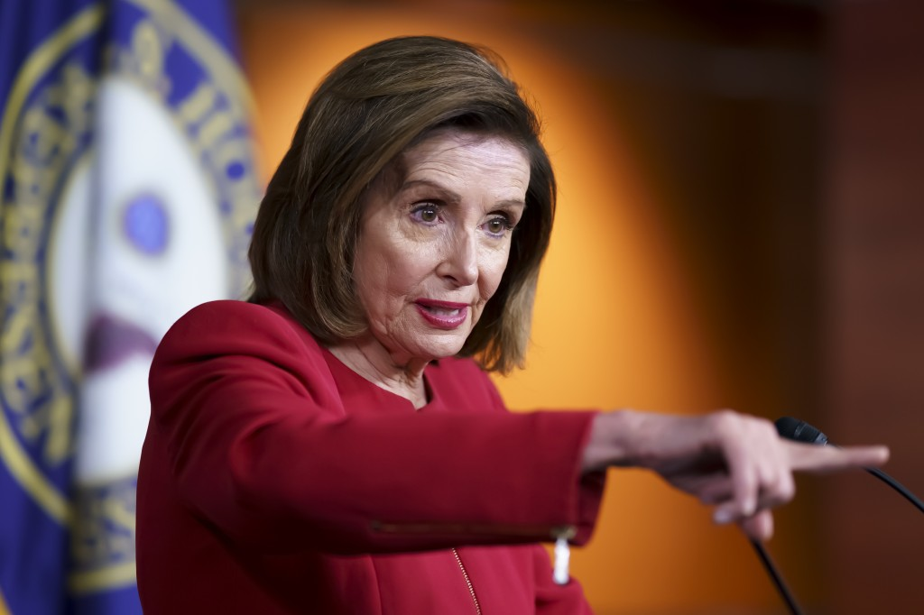 In this Sept. 8, 2021 photo, Speaker of the House Nancy Pelosi, D-Calif., meets with reporters to discuss President Joe Biden's domestic agenda at the...