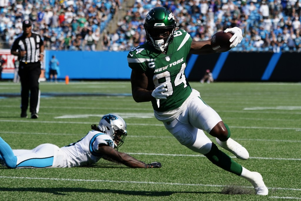 New York Jets wide receiver Corey Davis runs against the Carolina Panthers during the second half of an NFL football game Sunday, Sept. 12, 2021, in C...