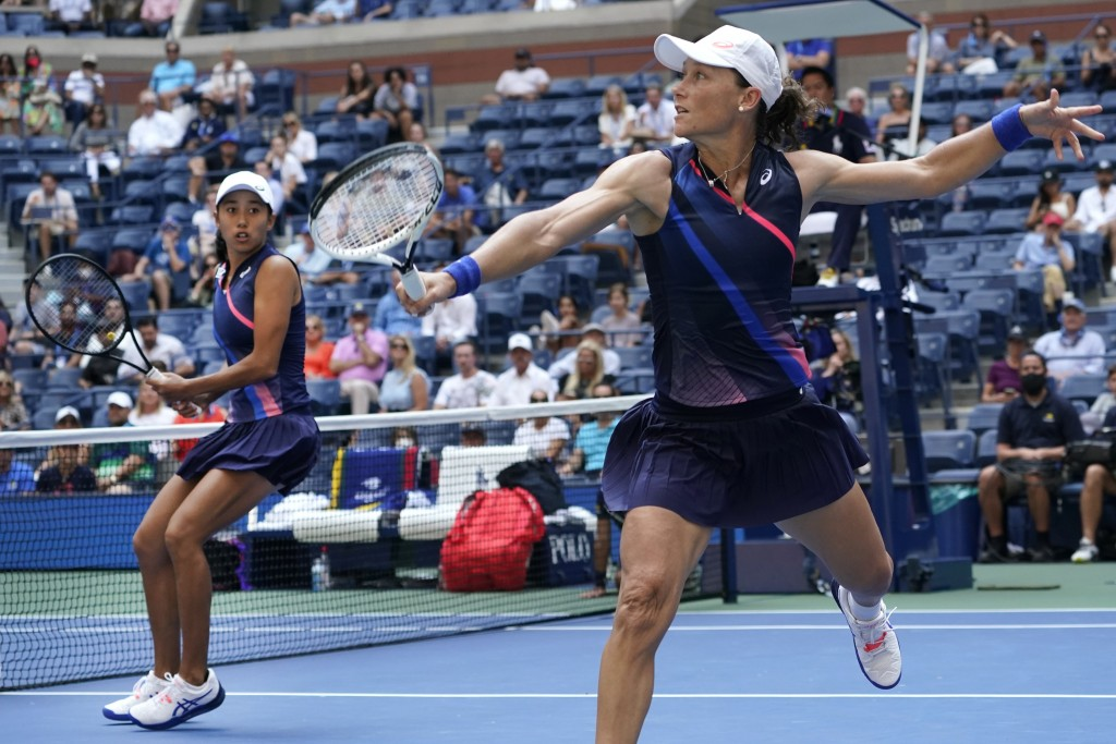 Shual Zhang, of China, left, and Samatha Stosur, of Australia, compete against Coco Gauff and Catherine McNally, both of the United States, during the...