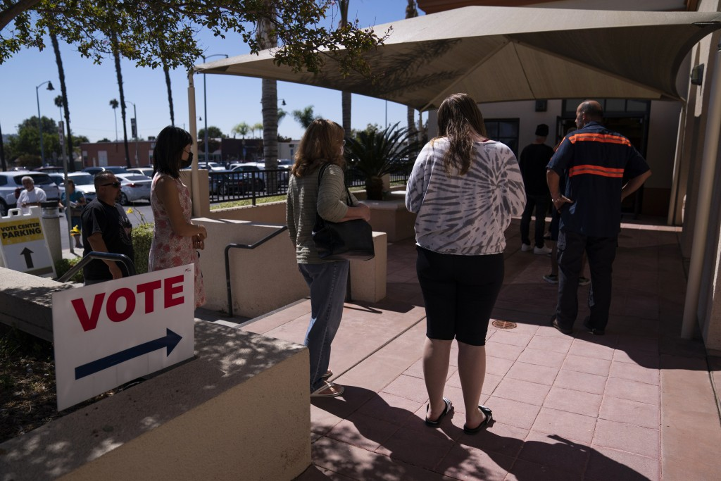 People wait in line to vote outside a vote center Tuesday, Sept. 14, 2021, in La Habra, Calif. With Gov. Gavin Newsom's fate at stake, Californians on...