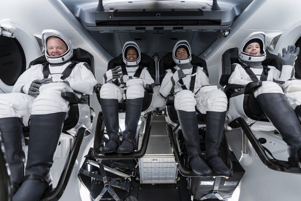 In this Sunday, Sept. 12, 2021 photo made available by SpaceX, from left, Chris Sembroski, Sian Proctor, Jared Isaacman and Hayley Arceneaux sit in th...