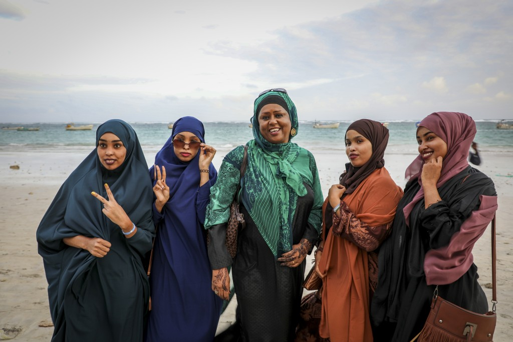 Somali Parliament member Fawzia Yusuf H. Adam, center, chats with campaign supporters at Lido beach in Mogadishu, Somalia Monday, July 19, 2021. The w...