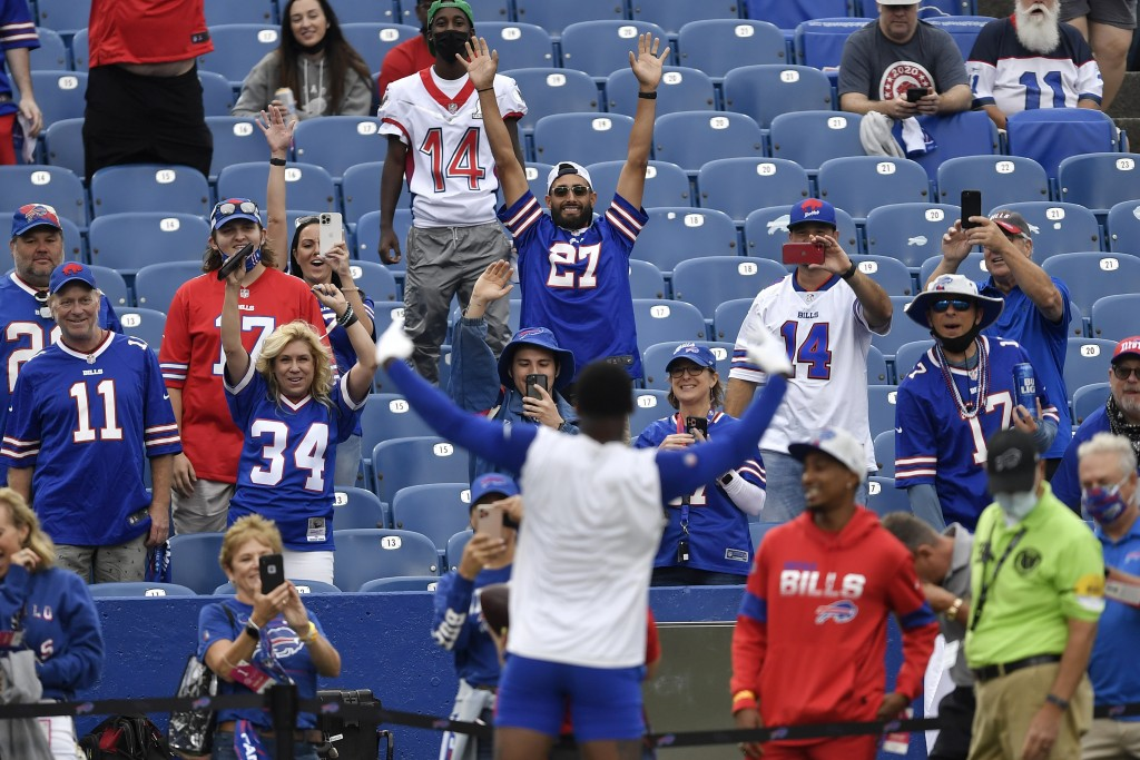 Buffalo Bills fans react as they watch warmups before an NFL football game against the Pittsburgh Steelers in Orchard Park, N.Y., Sunday, Sept. 12, 20...