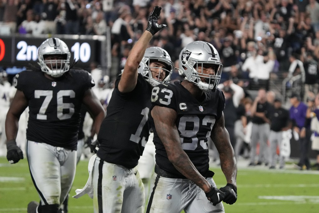 Las Vegas Raiders tight end Darren Waller (83) celebrates after scoring a touchdown against the Baltimore Ravens during the second half of an NFL foot...
