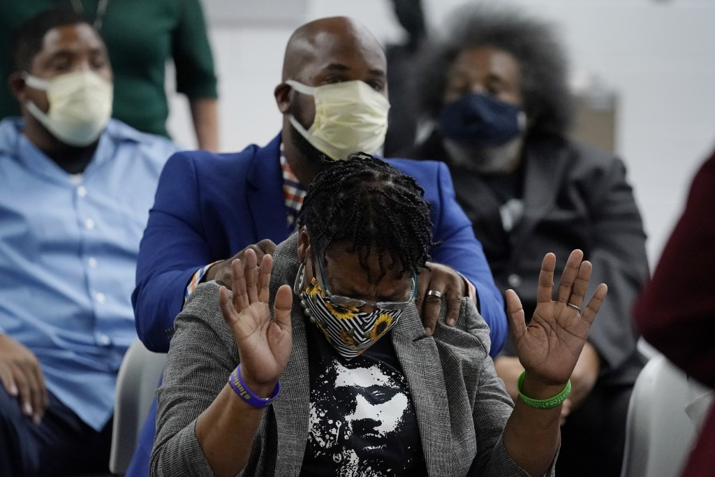Madeline Davis-Jones, the mother of Julius Jones, reacts as she hears the recommendation that her son's death sentence be commuted to life in prison b...