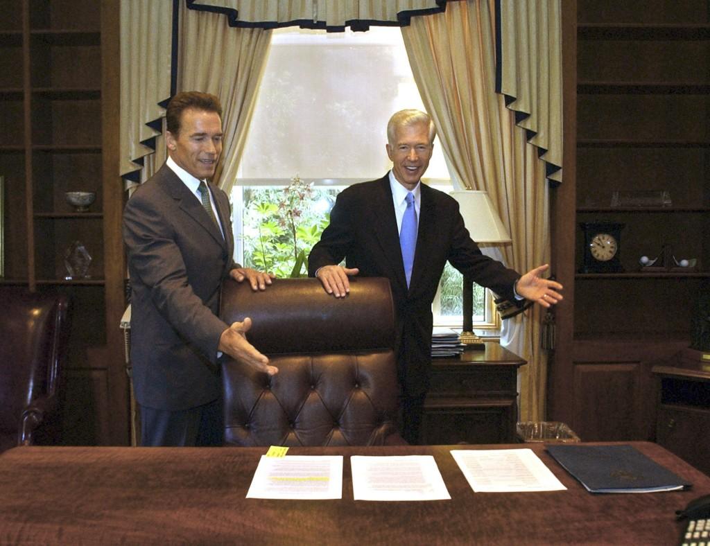 FILE — In this Oct. 23, 2003 file photo, Gov.-elect Arnold Schwarzenegger, left, and Gov. Gray Davis joke with each other as Davis shows Schwarzenegge...