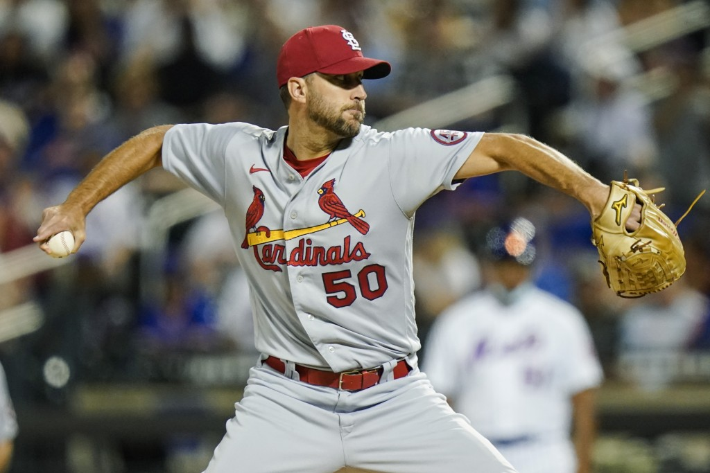 St. Louis Cardinals' Adam Wainwright delivers a pitch during the first inning of a baseball game against the New York Mets, Monday, Sept. 13, 2021, in...