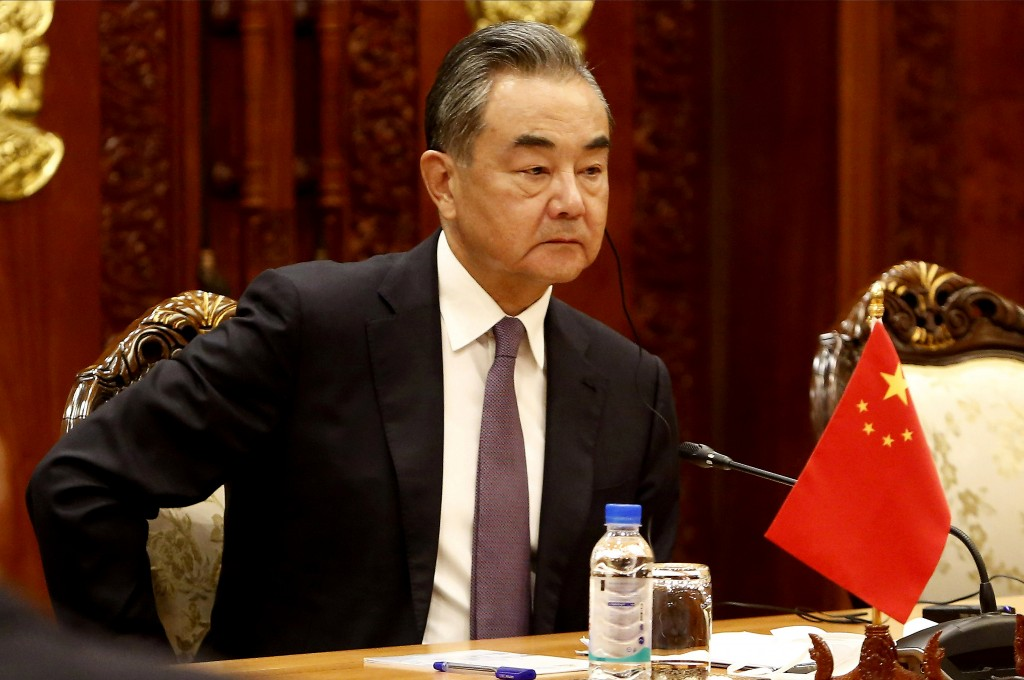 Chinese Foreign Minister Wang Yi listens to his Cambodian counterpart Prak Sokhonn during a meeting in Phnom Penh, Cambodia, Sunday, Sept. 12, 2021. W...