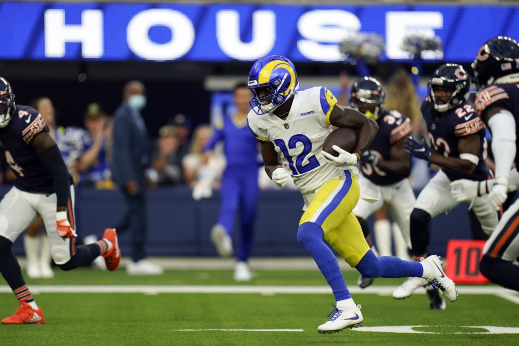 Los Angeles Rams wide receiver Van Jefferson runs on his way for a touchdown during the first half of an NFL football game against the Chicago Bears, ...