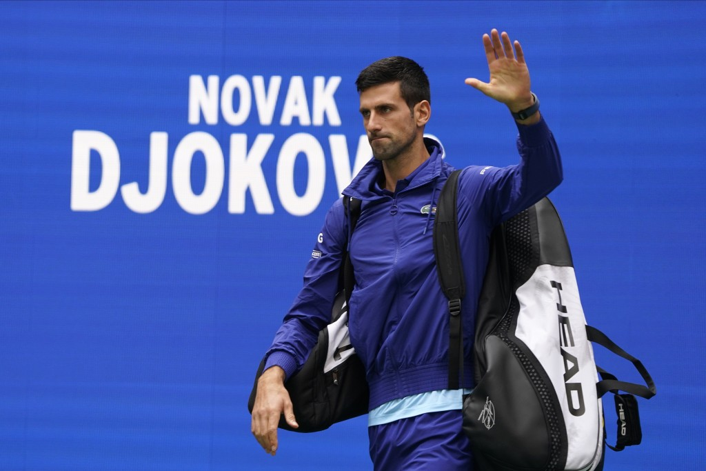 Novak Djokovic, of Serbia, walks onto the court to play against Daniil Medvedev, of Russia, in the men's singles final of the US Open tennis champions...