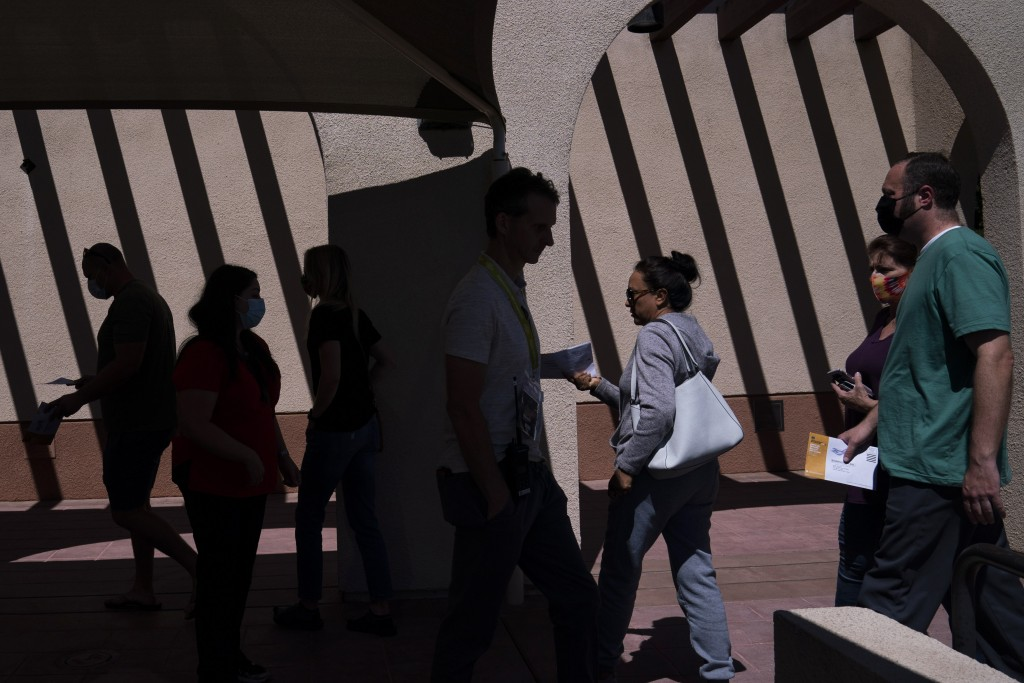 Voters arrive at a vote center to cast their ballots Tuesday, Sept. 14, 2021, in La Habra, Calif. With Gov. Gavin Newsom's fate at stake, Californians...