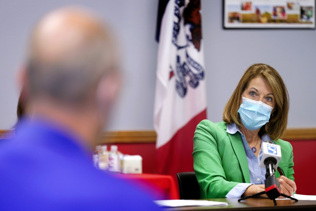 In this Sept. 2, 2021, photo Rep. Cindy Axne, D-Iowa, speaks about the Rural Reinvestment Task Force during a meeting with local officials in Indianol...