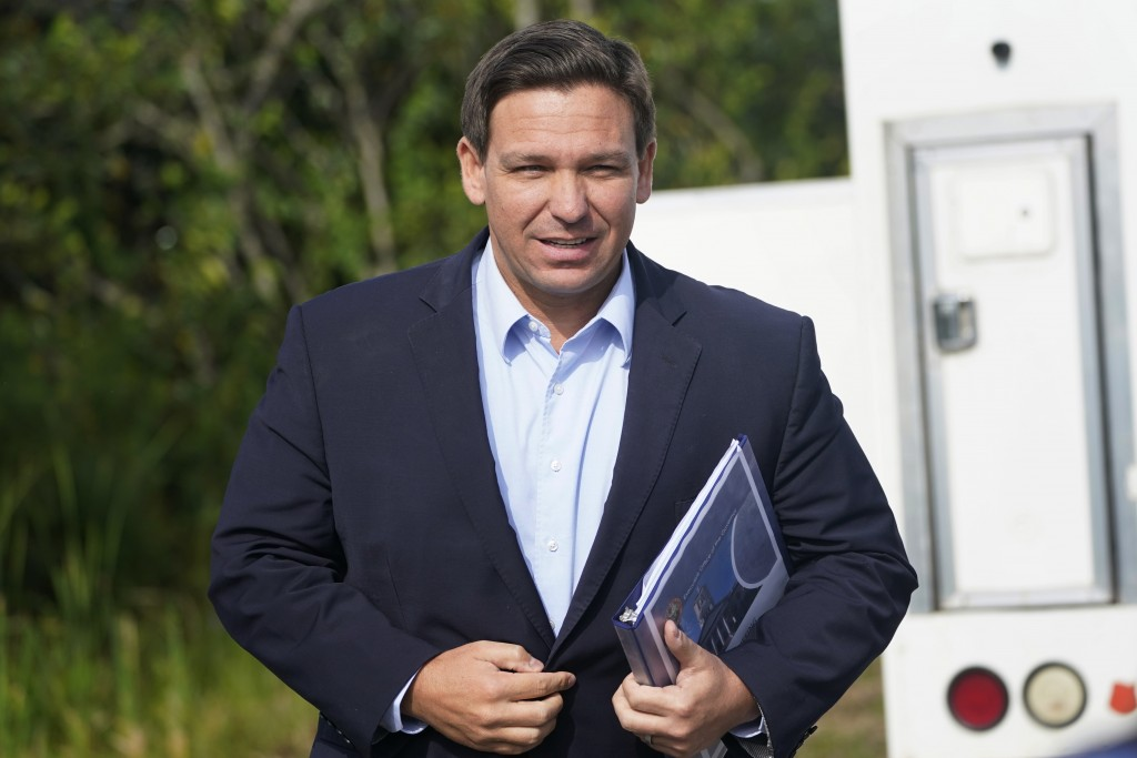 FILE - In this Tuesday, Aug. 3, 2021, file photo, Florida Gov. Ron DeSantis arrives at a news conference, near the Shark Valley Visitor Center in Miam...