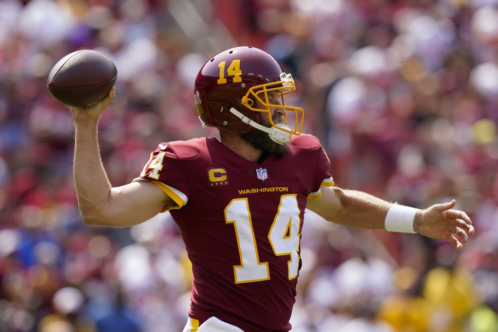 Washington Football Team quarterback Ryan Fitzpatrick (14) throws the ball during the first half of an NFL football game, Sunday, Sept. 12, 2021, in L...