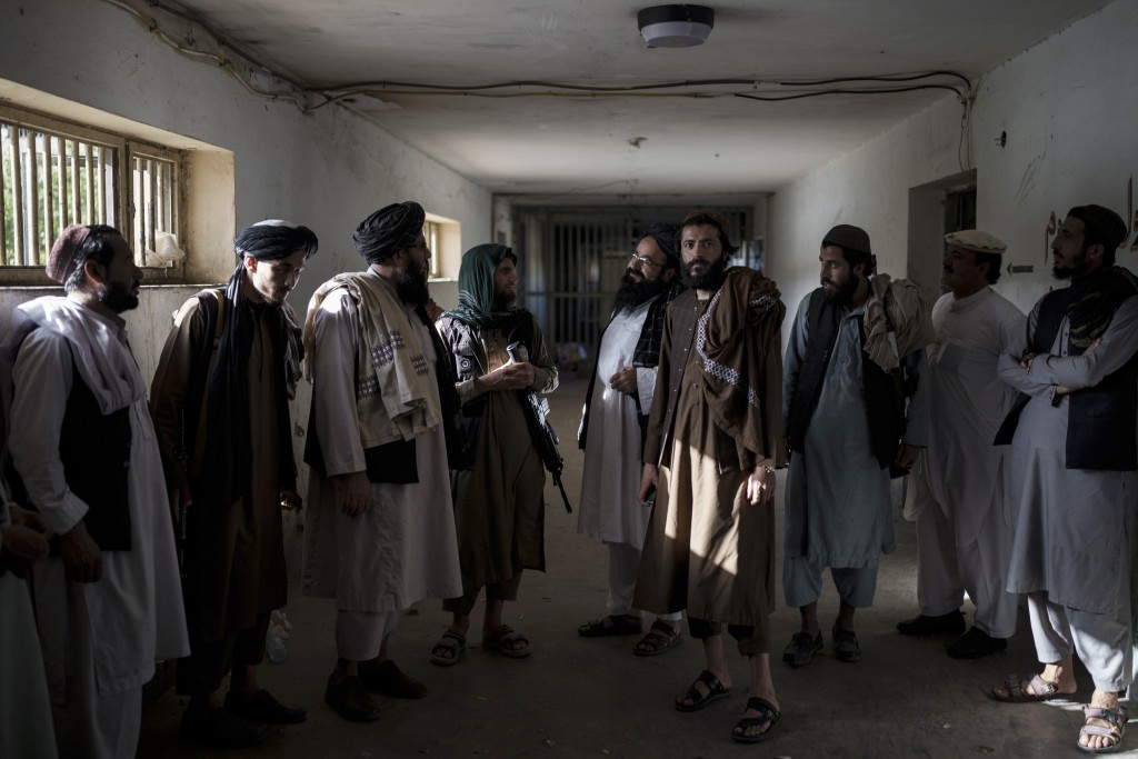 Taliban fighters, some former prisoners, chat in an empty area of the Pul-e-Charkhi prison in Kabul, Afghanistan, Monday, Sept. 13, 2021. Pul-e-Charkh...