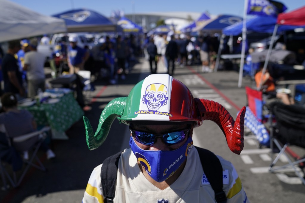 A fan of the Los Angeles Rams tailgates before an NFL football game against the Chicago Bears at SoFi Stadium Sunday, Sept. 12, 2021, in Inglewood, Ca...