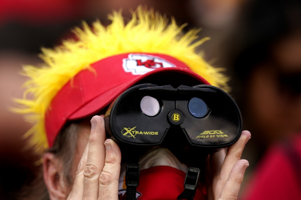 A fan watches during the second half of an NFL football game between the Kansas City Chiefs and the Cleveland Browns Sunday, Sept. 12, 2021, in Kansas...