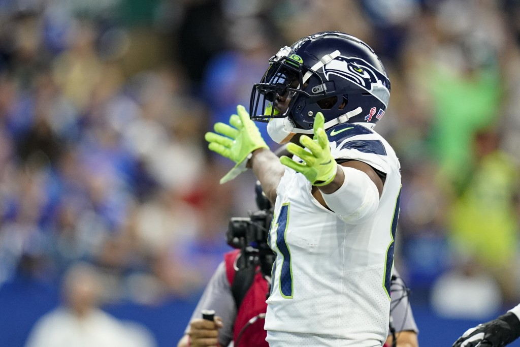 Seattle Seahawks tight end Gerald Everett (81) celebrates a touchdown against the Indianapolis Colts in the first half of an NFL football game in Indi...