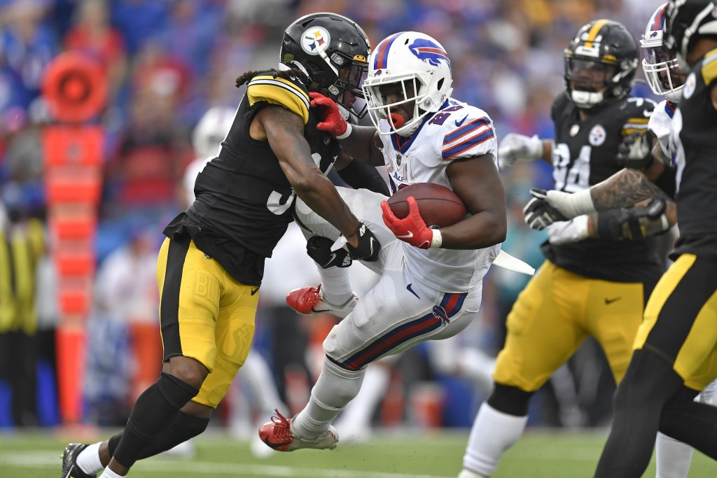 Buffalo Bills running back Devin Singletary (26) is tackled by Pittsburgh Steelers strong safety Terrell Edmunds, left, during the second half of an N...