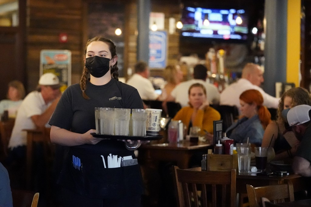 Mariah Tabb carries drinks to a table at Puckett's Grocery and Restaurant, Friday, Sept. 10, 2021, in Nashville, Tenn. In Nashville, tourism has come ...