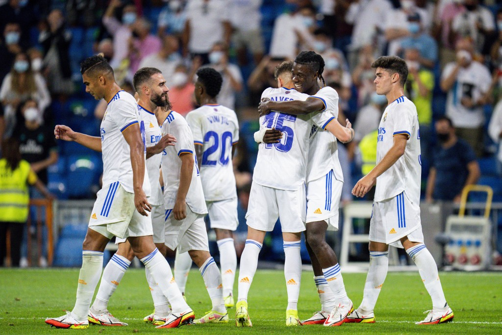 Real Madrid's Eduardo Camavinga, second right, celebrates with teammates after scoring during the Spanish La Liga soccer match between Real Madrid and...
